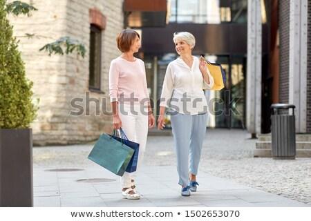 Supérieurs femme rue de la ville vente Photo stock © dolgachov