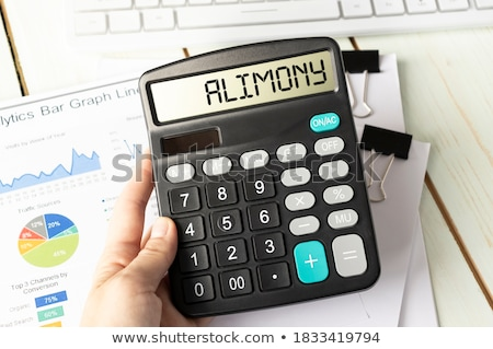 A calculator with the word Alimony on the display Stock photo © Zerbor