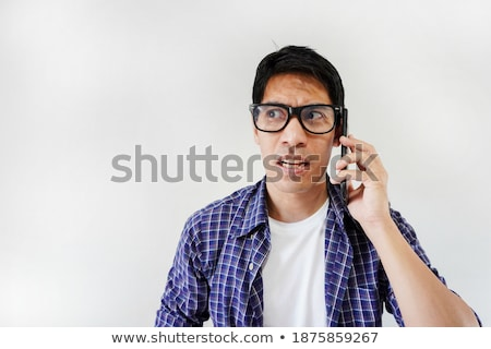 Confused nerd talking on a mobile phone Stock photo © majdansky