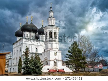 Kerk Rusland rivier boom zonsondergang landschap Stockfoto © borisb17