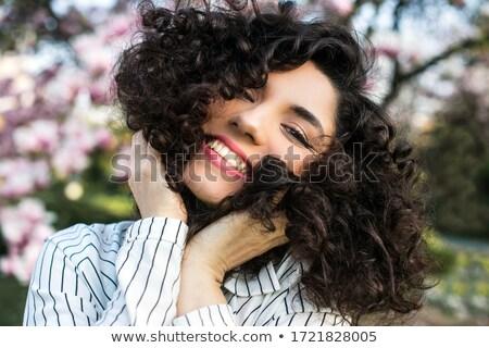 Portrait of a woman near a flowering magnolia tree outdoors Stock photo © ElenaBatkova