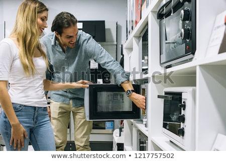 Compras homem eletrônica armazenar microonda compra Foto stock © robuart