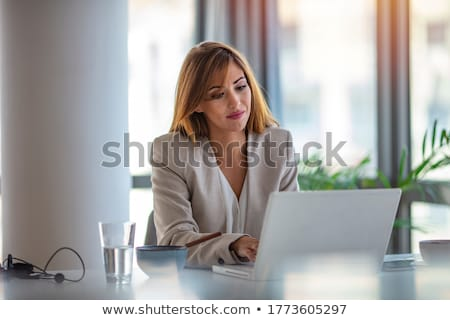 Horizontal shot of pleasant looking successful professional female lawyer learns clients case, works Stock photo © vkstudio