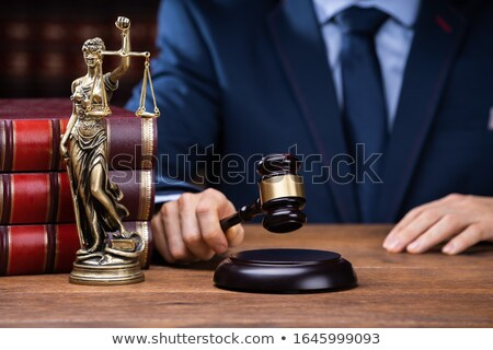 Judge Striking Gavel Near Mallet And Scales  Stock photo © AndreyPopov