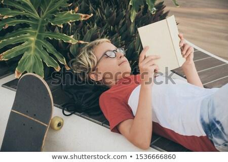 Fiú olvas kívül fiatal srác kint fű Stock fotó © diomedes66