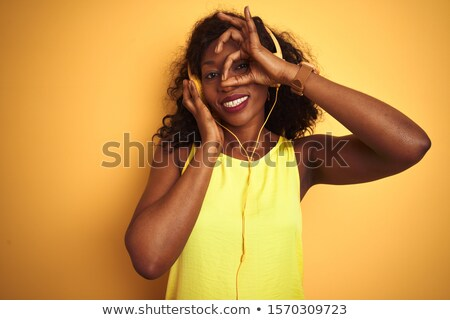 black woman hearing music through headphones Stock photo © photography33