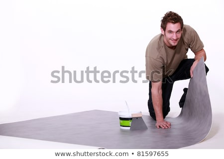 handyman putting a lino on the floor Stock photo © photography33