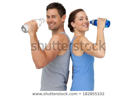 Sporty woman and man drinking water on white background Stock photo © photography33