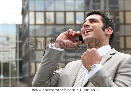 Encantado empresário telefone cara laptop tecnologia Foto stock © photography33