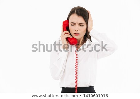 Woman talking on a telephone handset Stock photo © stryjek
