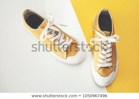 желтый кроссовки темно ретро ногу обуви Сток-фото © czaroot