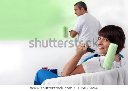 Frau vorsichtig Malerei Wand Haus Mädchen Stock foto © photography33