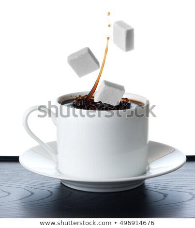 Taza té caer terrones de azúcar naranja beber Foto stock © ozaiachin