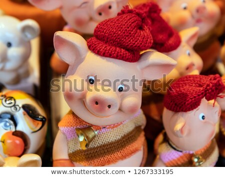 Souvenir - a toy a pig on a white background. isolated Stock photo © acidgrey