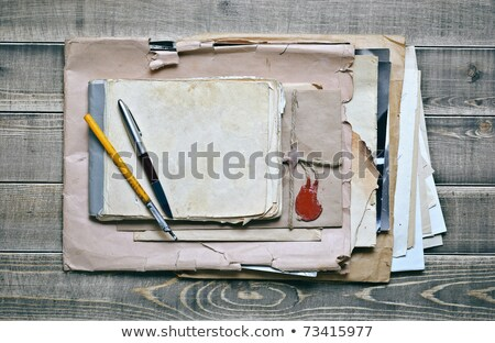 stack of old papers with a wax seal on wooden background Stock photo © inxti