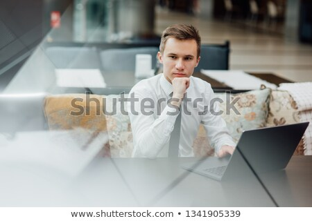 pensive young businessman sat at desk stock photo © photography33