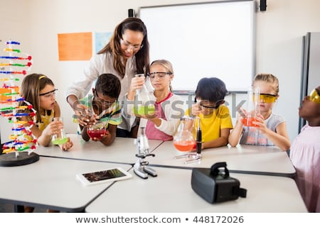 Science teacher with pupil Stock photo © photography33