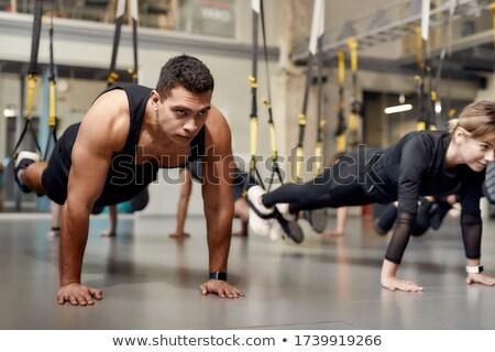 спортзал Бар тренировки человека женщину Сток-фото © lunamarina