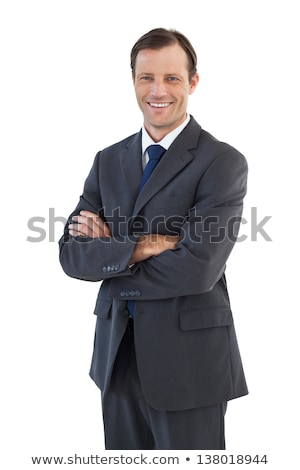 Well-dressed  self-assured businessman looking at the camera against a white background Stock photo © wavebreak_media