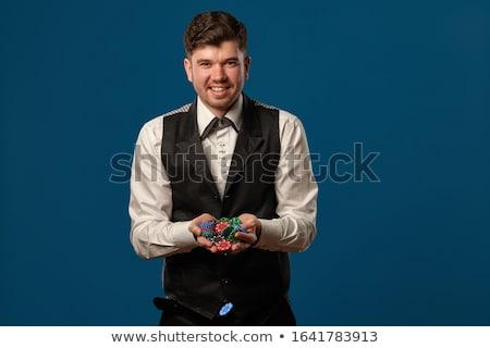 Black and white poker tokens against a white background Stock photo © wavebreak_media