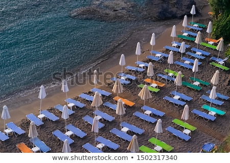 Sunshades at an empty beach Stock photo © elxeneize