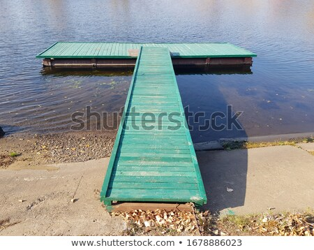 Wooden pier on a misty day reflecting in the water Stock photo © Bertl123