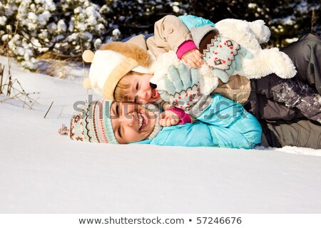 mother and daughter giggling in the snow stock photo © photography33