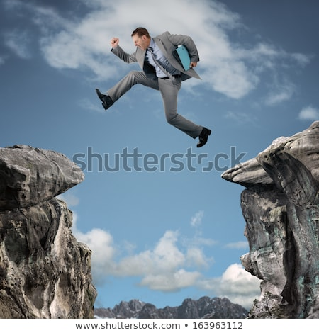 agile businessman leaping in the air stock photo © smithore