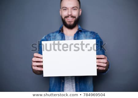 Businessman with a blank white sign Stock photo © smithore