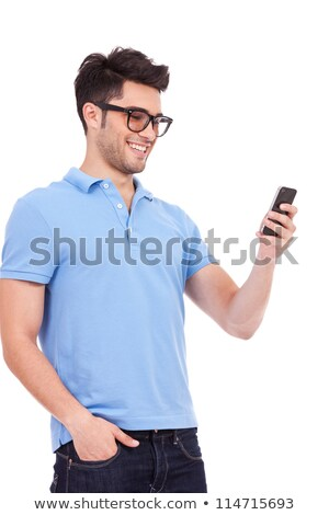 Portrait of Boy holding cell phone Stock photo © zzve