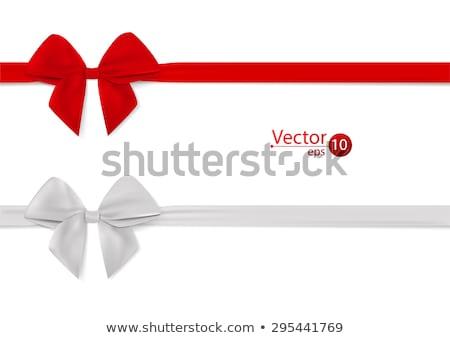 beautiful red gift with white ribbon isolated on white stock photo © tetkoren