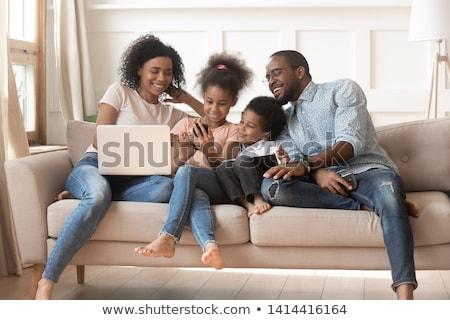 femme · souriante · canapé · portable · téléphone · portable · maison · femmes - photo stock © stokkete
