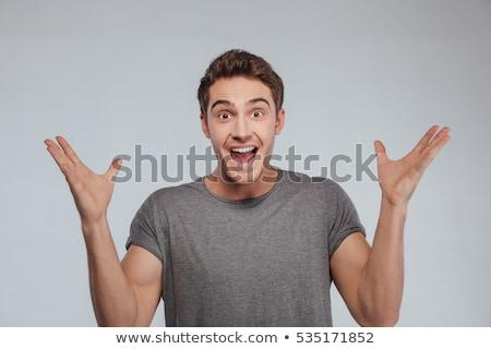 Opgewonden man volwassen man handen witte gelukkig Stockfoto © AndreyPopov