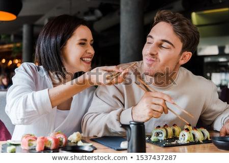 Couple manger sushis dîner romantique avancé Photo stock © Kzenon