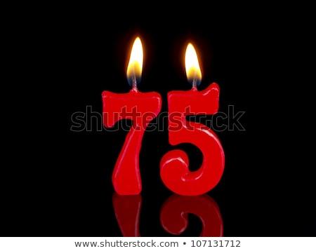 burning birthday candles number 75 stock photo © zerbor