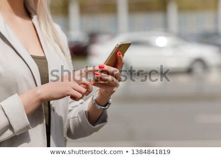 automatikus · parkolás · kéz · tart · telefon · autó - stock fotó © lightpoet