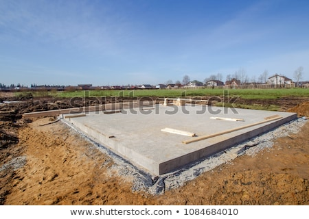 Stock photo: material at a construction site for the base of a new house