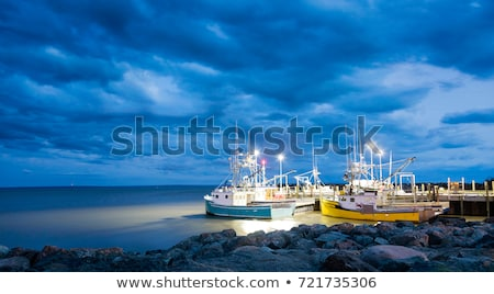 Fishing boat moored in a harbor Stock photo © speedfighter