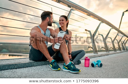 Couple resting after running Stock photo © HASLOO