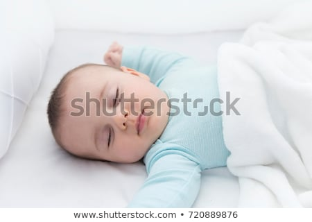 Close-up of a baby boy lying in a crib Stock photo © bmonteny