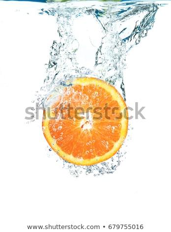 Orange water splash Stock photo © klss
