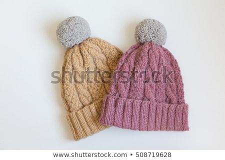 Knit wool hat on wood table Stock photo © nalinratphi