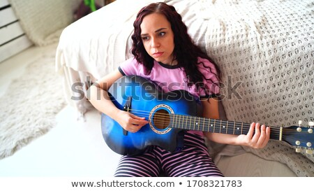 Pretty lady enjoying spare time in her bed Stock photo © arturkurjan