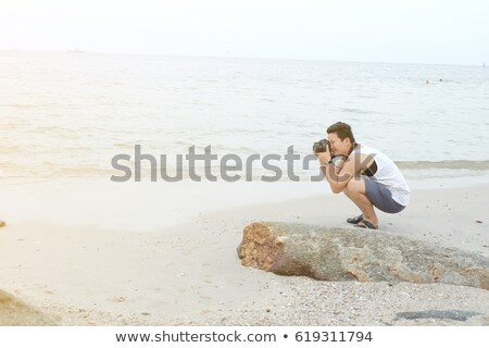 man taking a photo l stock photo © toocan