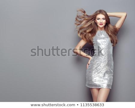 Сток-фото: улыбаясь · девушки · серый · платье · позируют · волос