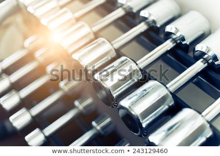 Poids haltères rack gymnase exercice Photo stock © alexmillos