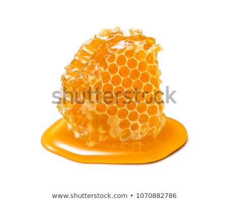 A nido d'ape miele primo piano legno vetro pasto Foto d'archivio © nito