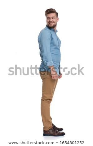 Homem bonito olhando ombro isolado branco Foto stock © alexandrenunes