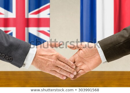 Representatives of the UK and France shake hands Stock photo © Zerbor