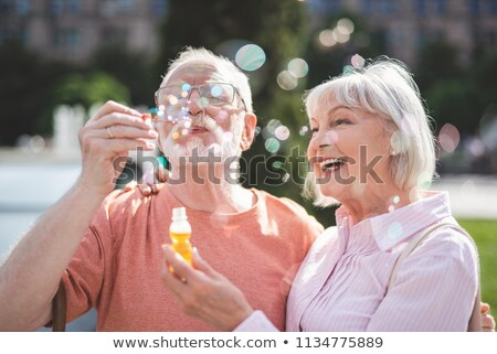 woman blowing soap bubbles on street stock photo © ssuaphoto